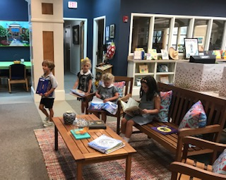 Lower school students check out books