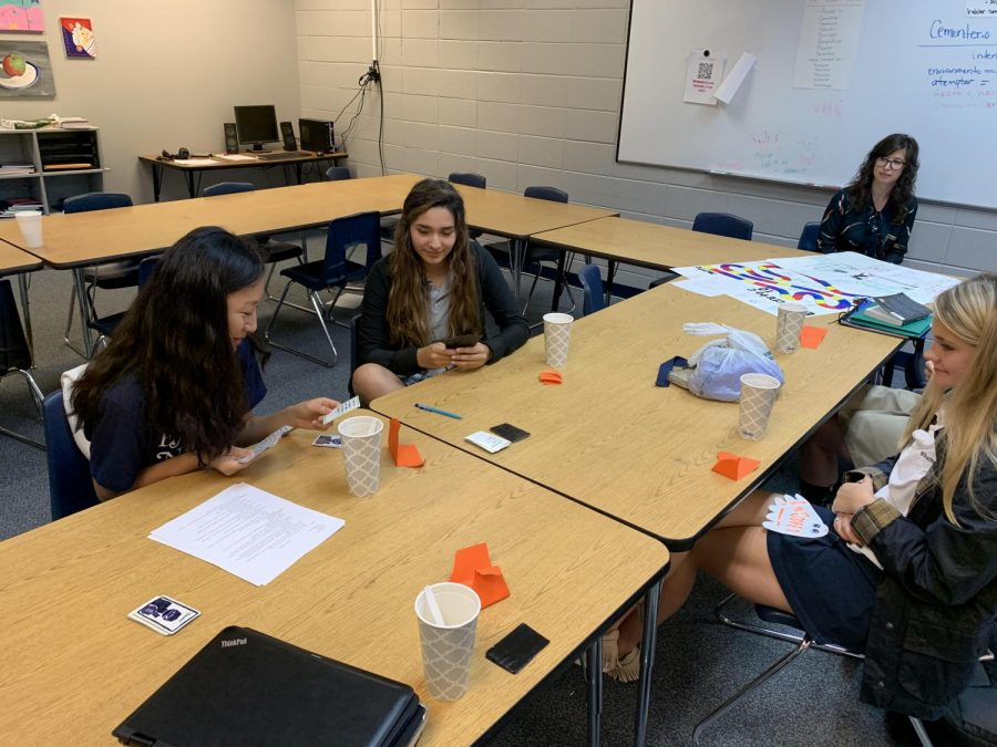 The Spanish 4 class plays games that they created after reading a short novel called Eres Tu, Maria?