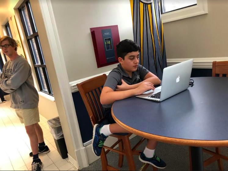 Shazad Mizori studying, Graham Hefner in background