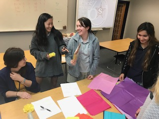 The Spanish 4 class makes paper flowers.