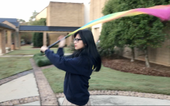 Junior Alex Hall can toss, spin flags with the best of them