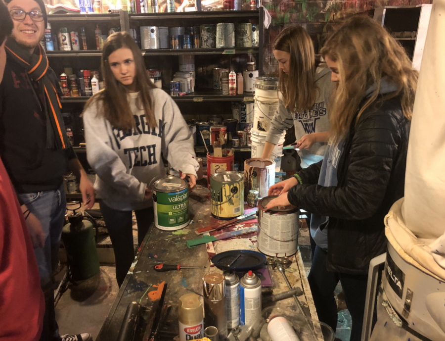 Juniors roll up their sleeves, then have afternoon of fun