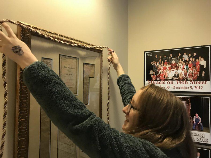 Gabrielle Rader decorates Macon Little Theatre.