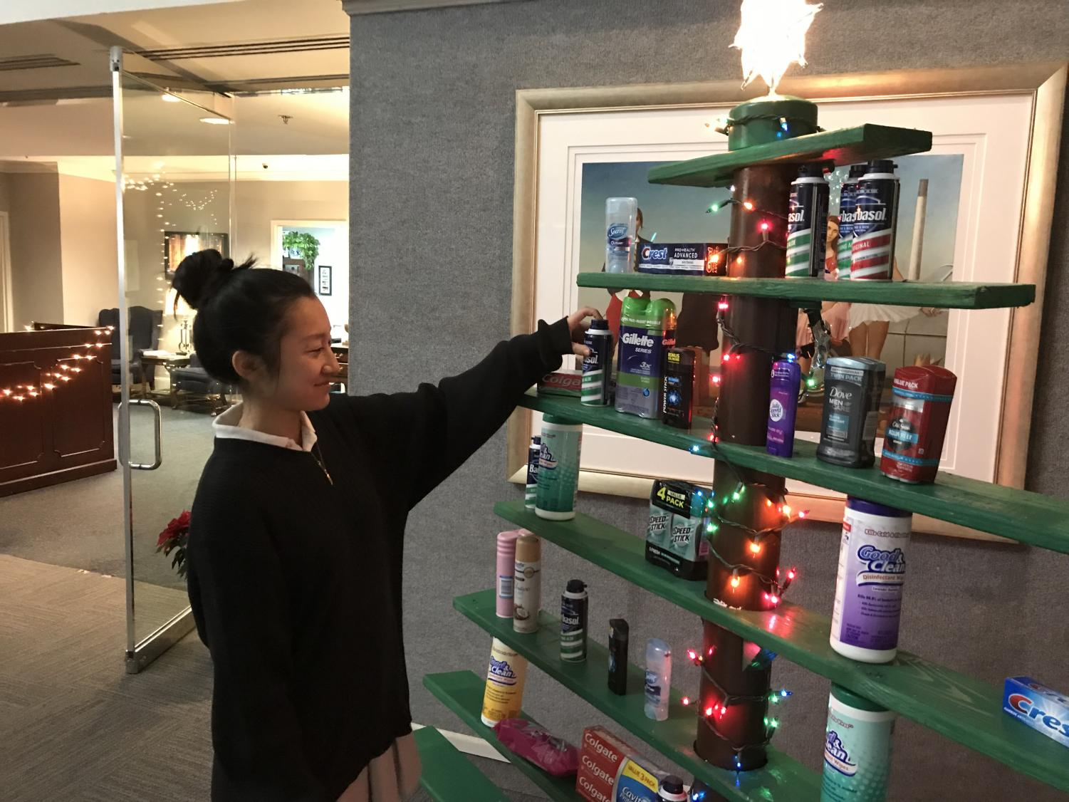 Jocelyn Tang admires Christmas tree that design class created.