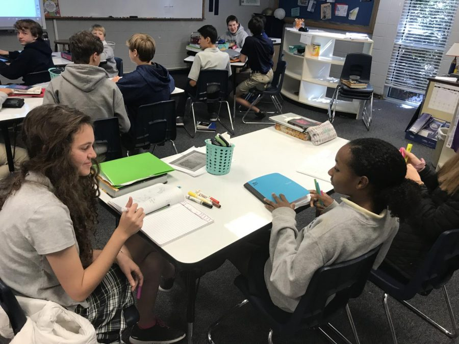 Eighth graders Ranya Ajjan and Jai Stephens get ready for geometry.