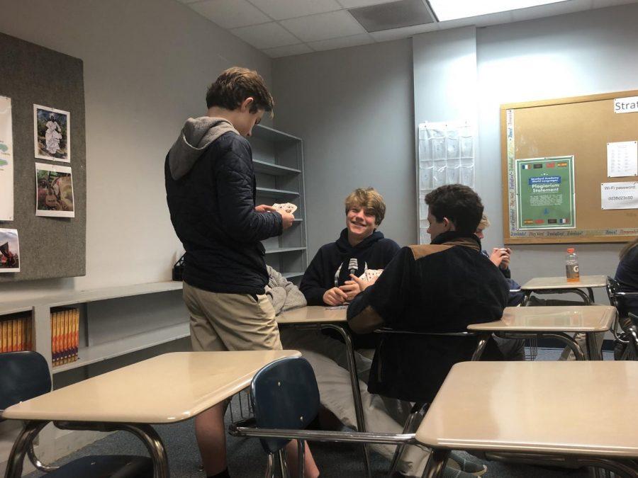 Kjell Stevenson, Will Tiller, and Paul Harrington playing cards in Spanish class