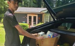 Haaris Ahmed loads food in his car to distribute to families in need