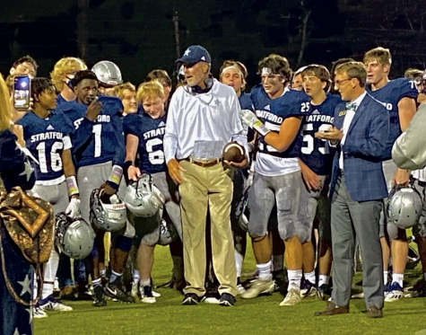 Coach Mark Farriba celebrates 200th career win with team, who presented him with the game ball