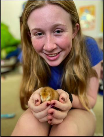 Nora holding a baby chick