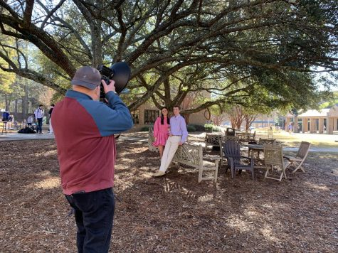"Lila McCord and Harrison Brown have their photo taken for ""Senior Superlatives"" by photographer Lee McDavid"