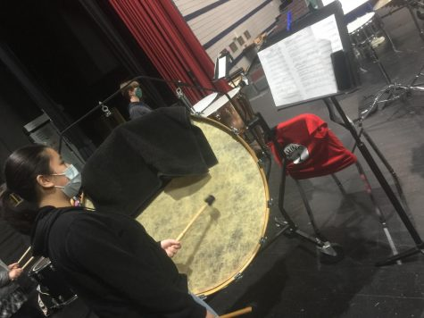 Suri Nguyen practices percussion during band rehearsal Thursday