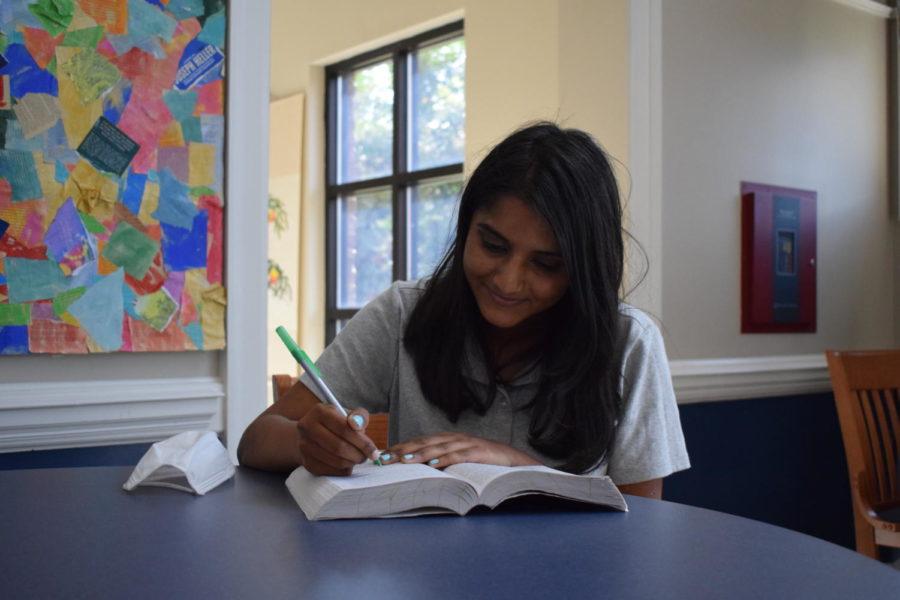 Senior Varnika Guduri studies in the lobby of the Olson Library