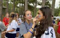 Molly Edward Seagraves, left, and Mia Bhafin enjoy face painting at freshman retreat