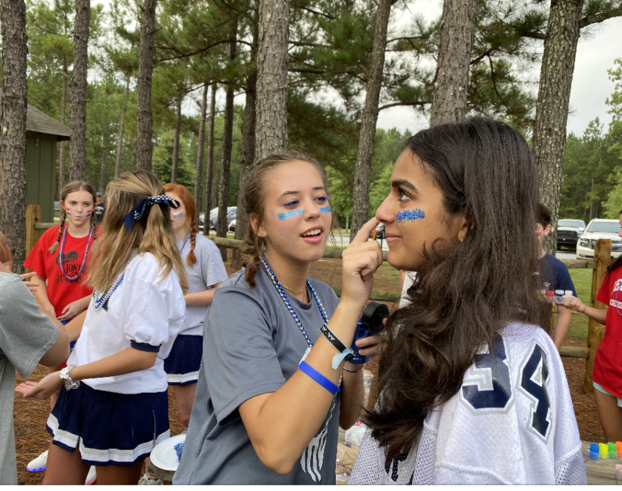 Molly+Edward+Seagraves%2C+left%2C+and+Mia+Bhafin+enjoy+face+painting+at+freshman+retreat