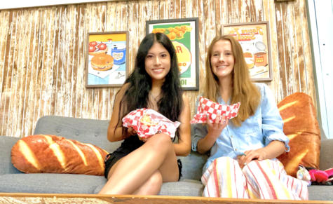 Two Annies -- Annie Shih and Annie Putzke -- enjoy the atmosphere at the new Macon Bagels on Third Street